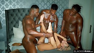 Three horny black guys are stretching one poor blonde cutie with their hard ache cocks