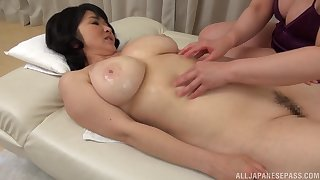 Mizuno Yoshie gives a massage to a chubby Asian sweeping and licks their way pussy