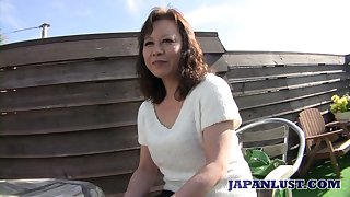 Of age Japanese lady Akemi Seo rides dig up added to gets her soaking slit stretched well
