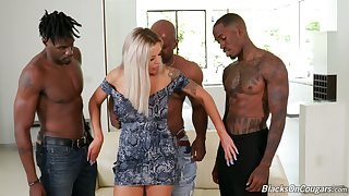 Sex-starved busty milf Nina Elle is fucked by a handful of big black fellows