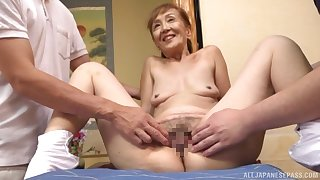 A remarkable threesome Japanese screw around with a sexy granny